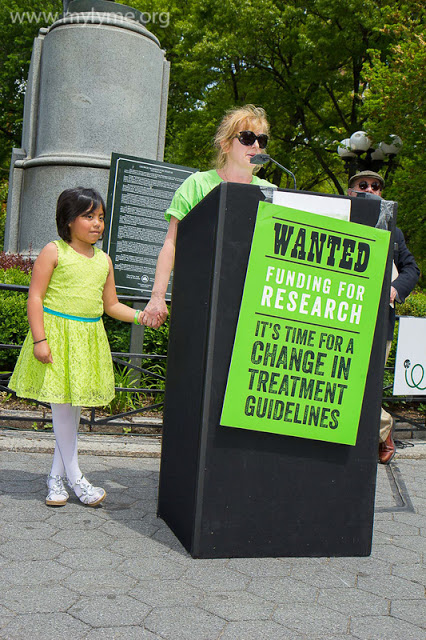 Eva Sapi, Lyme Researcher, addressing the crowd of Lyme patients while holding her daughter's hand. Photo by Chrysa http://mylyme.org/