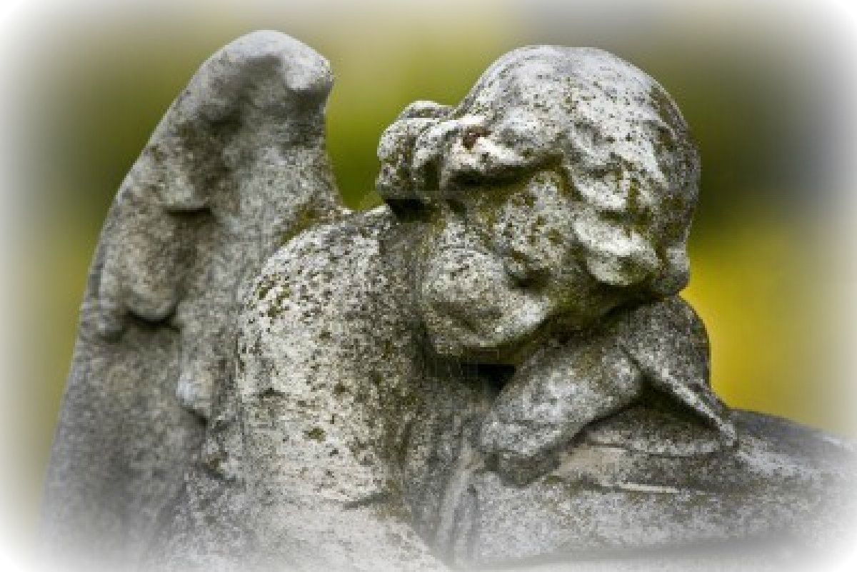 BeFunky_13271034-old-cemetery-angel-sculpture-made-of-stone.jpg
