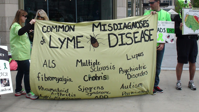 Julie holds up her Lyme Misdiagnosis Sign Photo from WWLDAP 2013