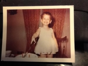 """This is one of my favorite pictures of Chrissy. Her second birthday, and she got to cut the cake with Daddy's big knife!"" ~Ellen Morbelli"