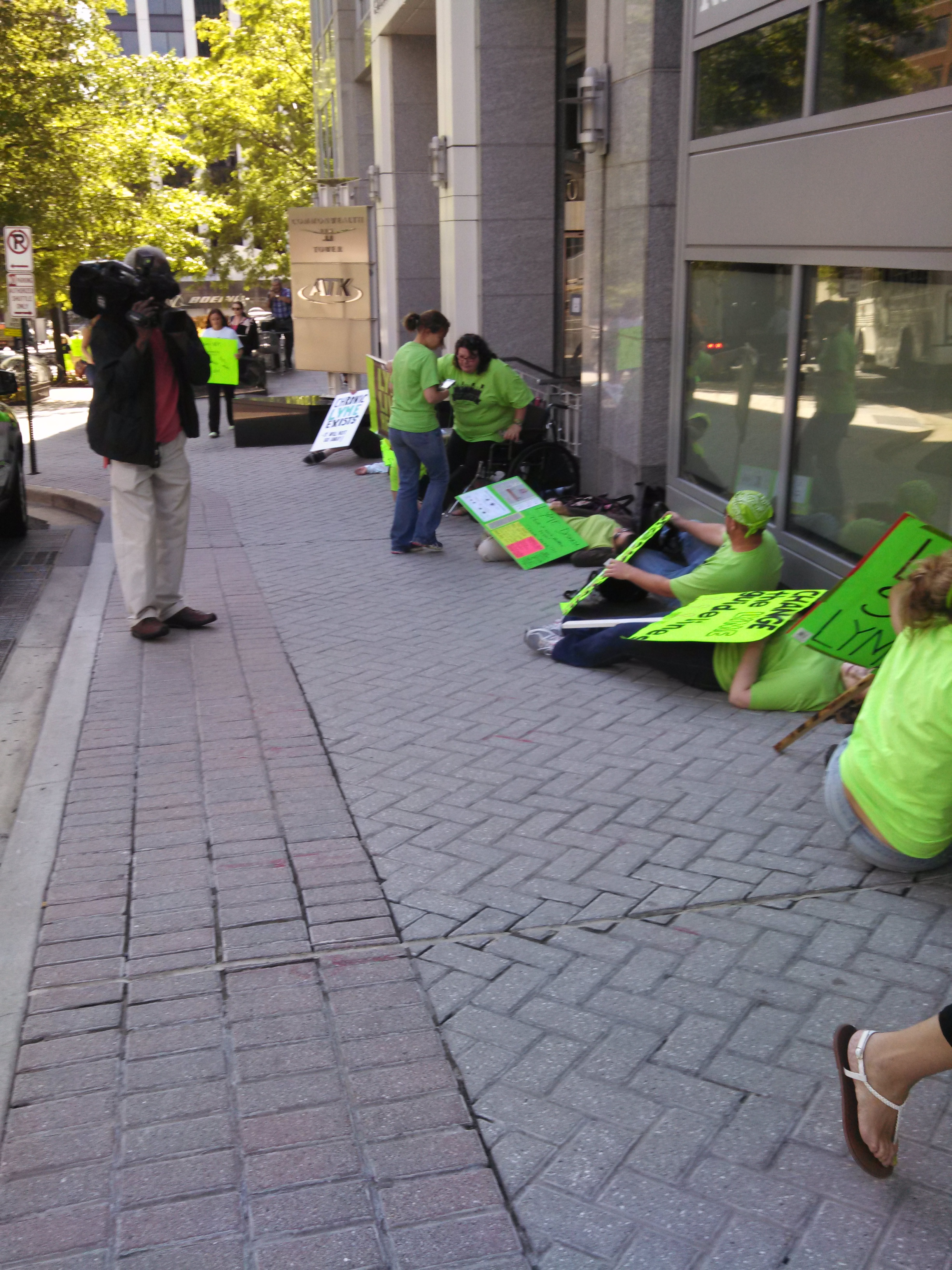 Lyme patients being videotaped by NBC during the Flash Die In in front of the IDSA Headquarters in Arlington, Va