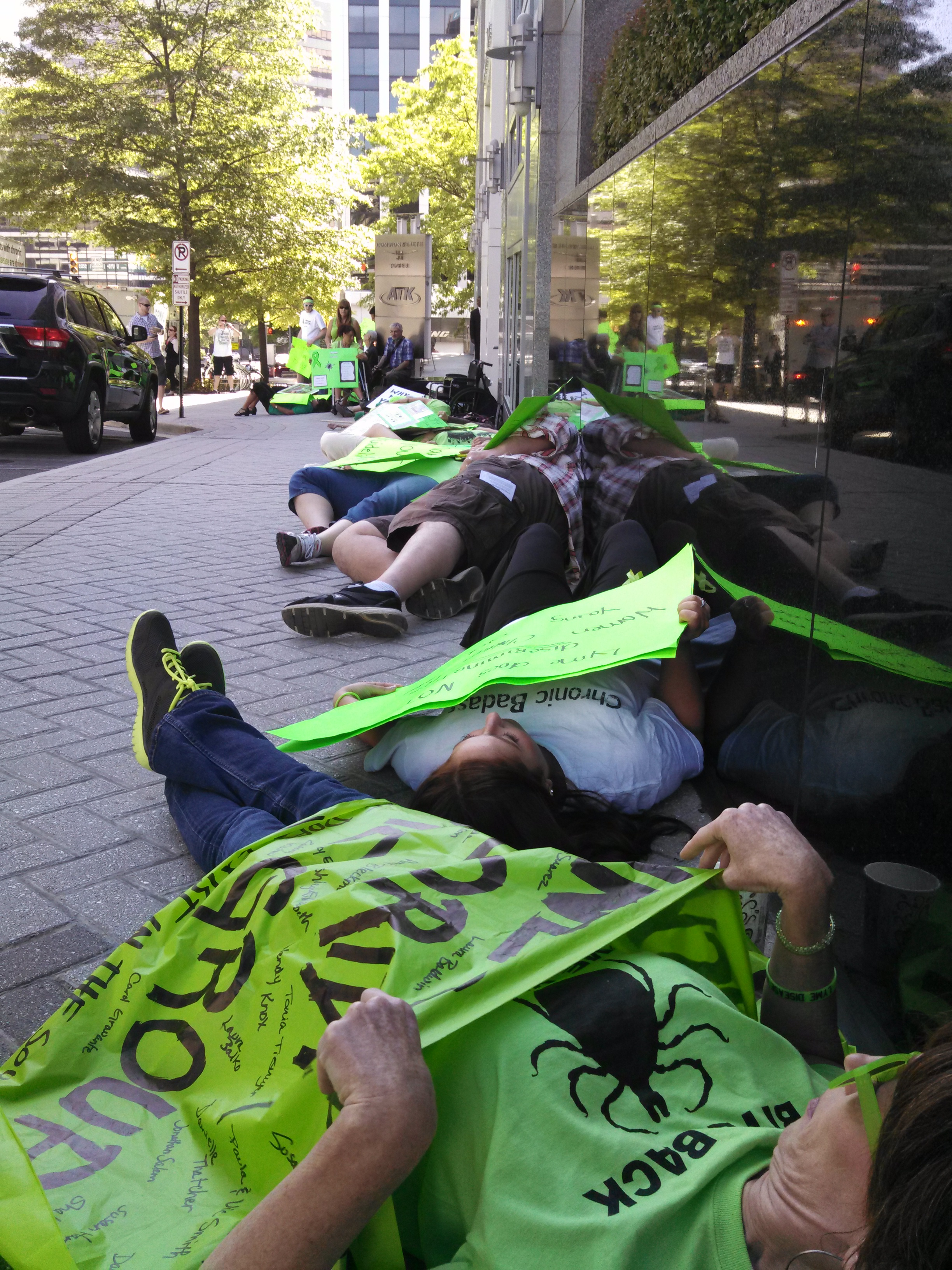 Flash Mob Die In in front of the IDSA Headquarters