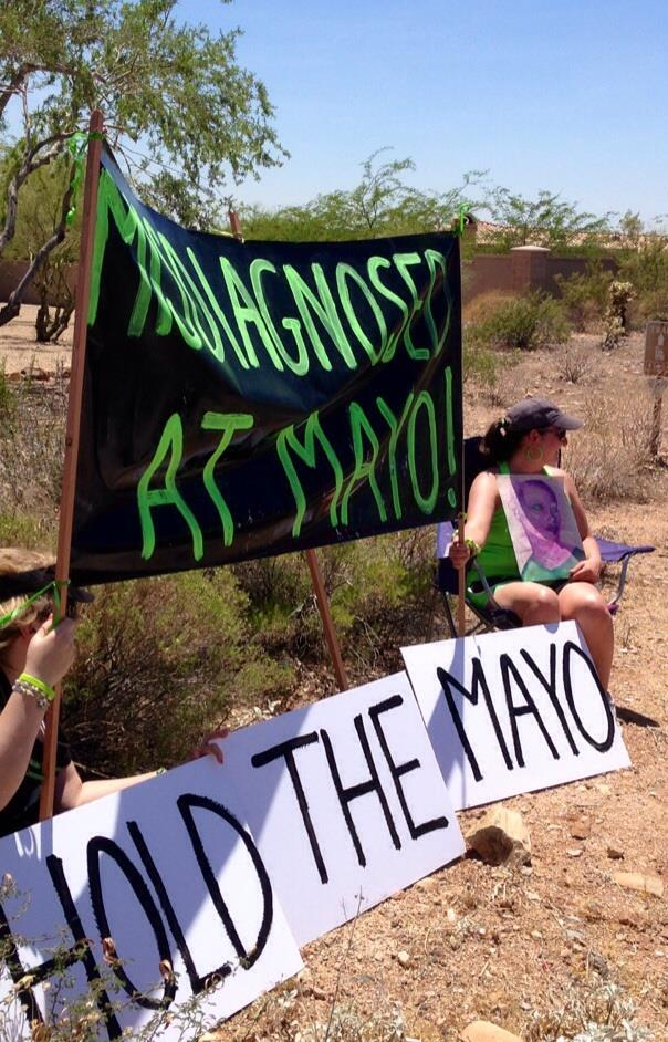 "Lyme Patients Hold up a Sign that says: ""Hold the Mayo."""