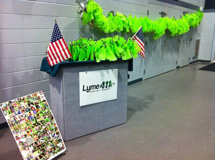 These flags represent all the people with Lyme that could not be here today. The ones with black ribbons (on the table and the ends of the hanging display) commemorate people who have passed away from Lyme. 500 of the 1200 flags have these ribbons.
