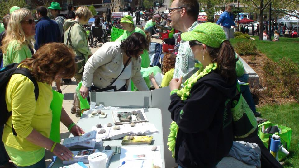 Kristin Collins and Paul Mall working the Lyme Awareness Booth at the Madison Worldwide Lyme Rally in 2014.