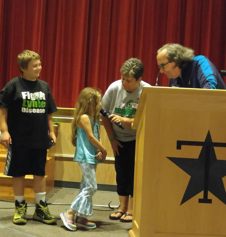 Dr Jones addressing the kids at the Lyme conference in Maine. Photo by Thaia Lukeandlexsmom